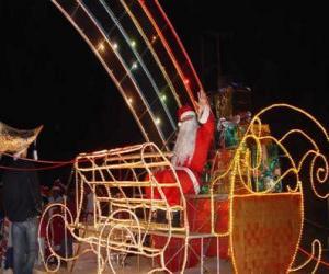 Układanka Święty Mikołaj machając do magicznego sanki załadowany