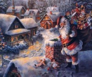 Układanka Święty Mikołaj na dachu domu obok komina