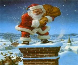 Układanka Święty Mikołaj następuje przez komin obciążony wieloma przedstawia