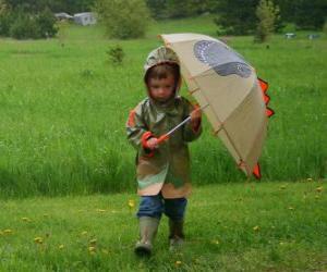 Układanka Chłopiec z jego parasol i kurtkę na deszcz wiosenny deszcz