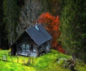 Układanka Chatce z drewna w górach