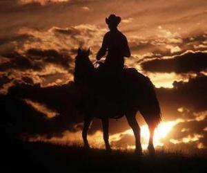 Układanka Cowboy jazda o zmierzchu
