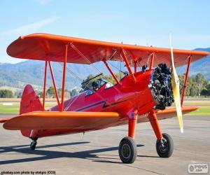 Układanka Czerwony dwupłatowy samolot