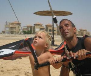 Układanka Dziecko robi pod Kania z ojcem