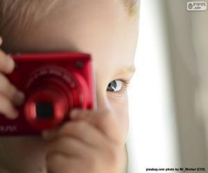 Układanka Dziecko z aparatem fotograficznym
