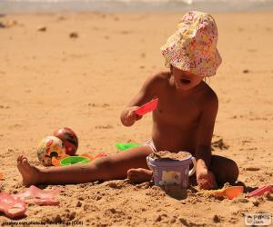 Układanka Dziewczyna gra na plaży