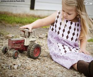 Układanka Dziewczyna gra z ciągnika