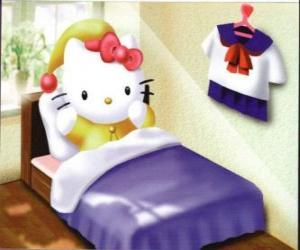Układanka Hello Kitty w łóżku