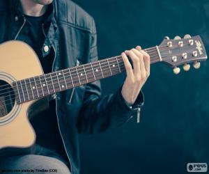 Układanka Muzyk grający na gitarze