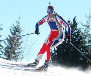 Układanka Narciarz w pełnym wysiłku w praktyce biegowym lub Narciarstwie