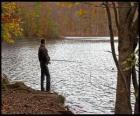 Wędkowanie - Rybacka w akcji rzeki zalesiony krajobraz