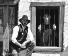 Stary szeryf z kowbojski kapelusz i gwiazdą na piersi