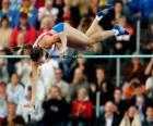 Sportowiec robi skok o tyczce