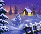 Mały dom w śniegu