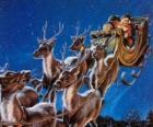 Magia reniferów ciągnąc sanie Świętego Mikołaja w noc Bożego Narodzenia