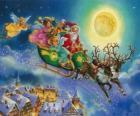 Santa Claus latające sanie nad domami podczas Wigilii