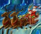 Sanie z prezentami loty z Santa Claus i reniferów magii