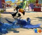 Rio film z jej trzech bohaterów: ary Blu, Jewel i tucan Rafael na plaży