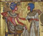 Faraona siedzącego na tronie z nejej berło, w formie biczem w ręku