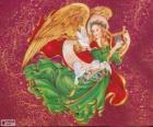 Anioł grając na harfie z okazji Bożego Narodzenia