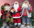 Trzy lalki Santa Claus
