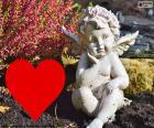 Amorek i czerwone serce