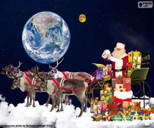 Układanka Sanie Świętego Mikołaja nad chmurami