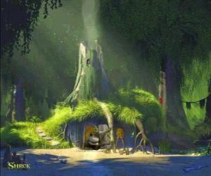 Układanka Shrek domu na bagnach otoczony zielenią