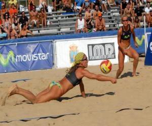 Układanka Siatkówka plażowa - Player oszczędności piłkę w oczach jego towarzysz