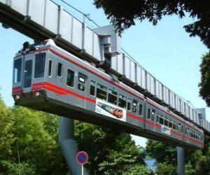 Układanka Zawieszone szynowe monorail. Pasażerowie szynowe monorail korzystających z widoków fairground